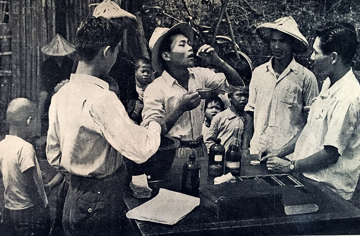 Vietnamese citizens taking their antimalarial treatment.